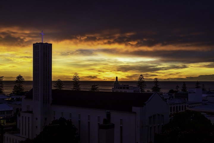 Cathedral Sunrise - A super colourful, dramatic sunrise over Napier with the Anglican Cathedral in the foreground.